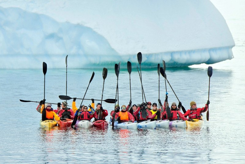 Antarctic kayakers celebrating their journey